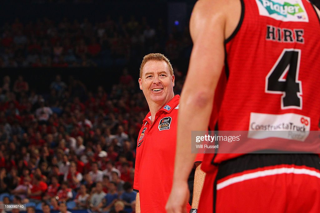 Wildcats coach Rob Beveridge speaks to Greg Hire during the round 14 NBL match between the Perth Wildcats and the Melbourne Tigers at Perth Arena on January 13, 2013 in Perth, Australia.