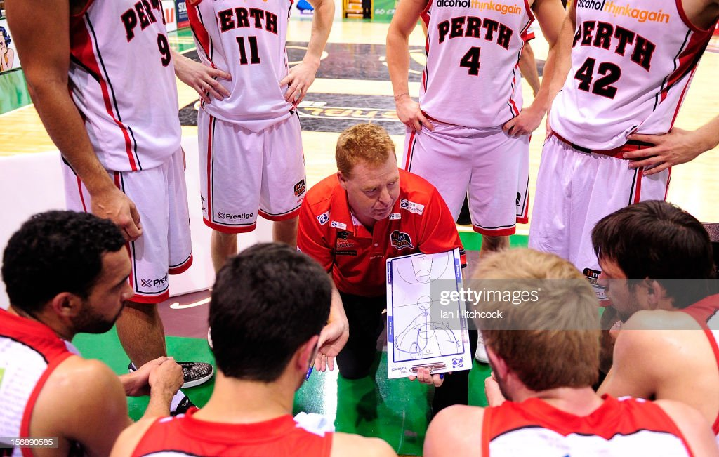 Wildcats coach Rob Beveridge talks to his players during a time out during the round eight NBL match between the Townsville Crocodiles and the Perth Wildcats at Townsville Entertainment Centre on November 24, 2012 in Townsville, Australia.