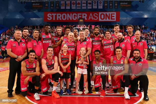 Wildcats players and coaching staff pose with Dawn and Trevor Gleeson and their children Taj and Shae after winning the round four NBL match between...