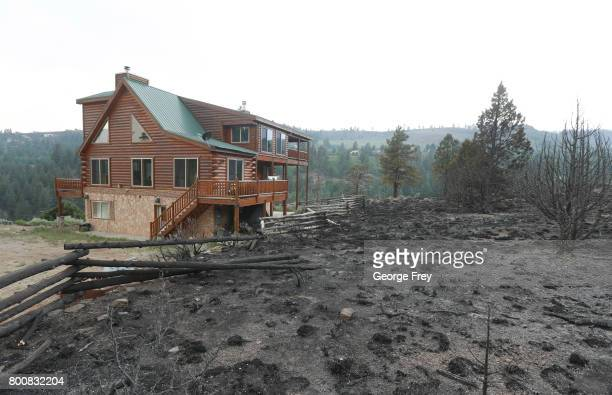 A wildfire burned up to the the edge of a home but left it standing on June 25 2017 outside Panguitch Utah The fire named the 'Brian Head Fire'...