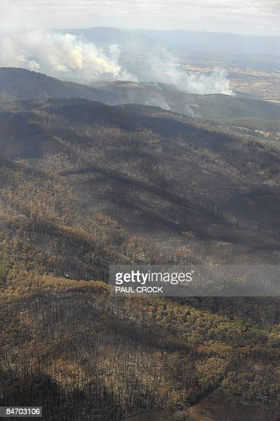 A wildfire contiunes to burn through the mountains after destroying farms and the Bunyip State Forest in LaTrobe Valley Gippsland some 100km east of...