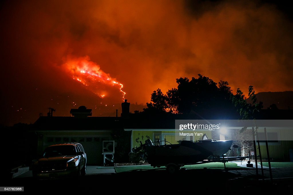 A wildfire rages up the mountain surrounding the Squirrel Mountain Valley neighborhood in Lake Isabella, Calif., on June 24, 2016.
