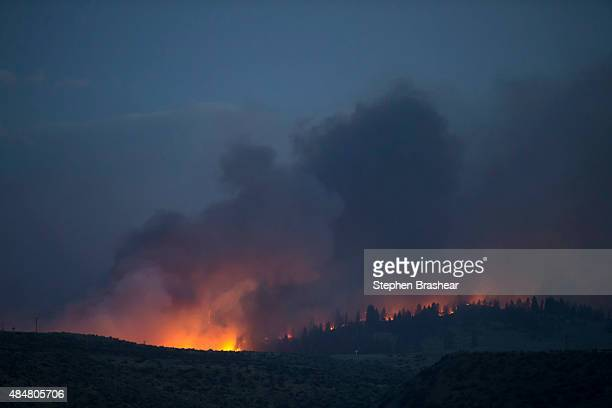 A wildfire which is part of the Okanogan Complex flares up on August 21 2015 in the hills near Omak Washington The fires which killed three...