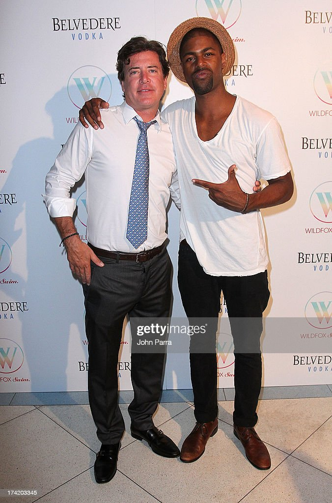 Wildfox CEO and President Jimmy Sommers (L) and Davaughn Nixon attend the Wildfox Swim Cruise 2014 show at Soho Beach House on July 21, 2013 in Miami Beach, Florida.