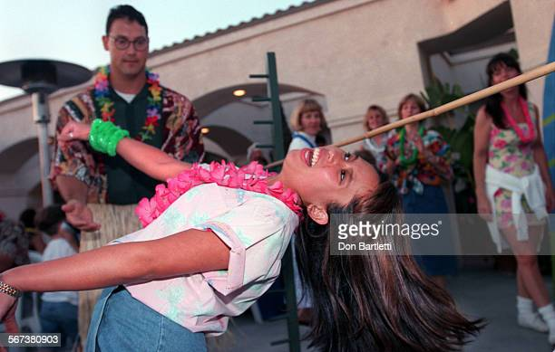 LSWildLimboDB5/16/97NewportBeach Thursday evening 5/15 at the Back Bay Cafe Bick Le gets under the limbo bar at the ÒWild IsleÓ party for members of...