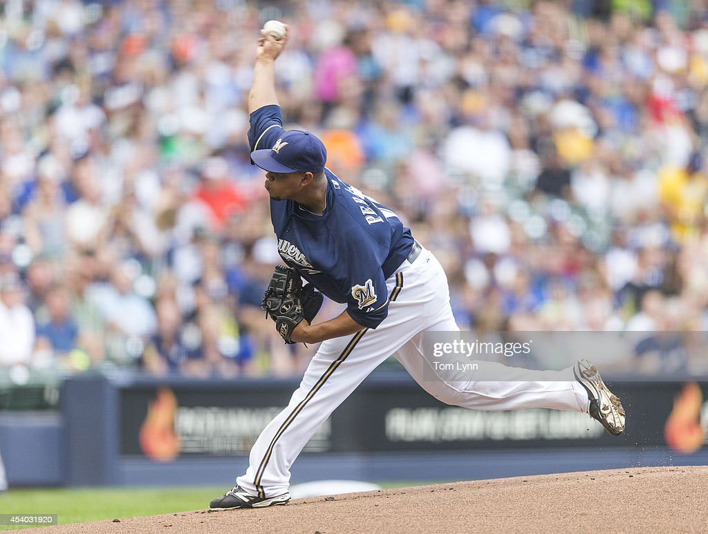 Wiley Peralta #38 of the Milwaukee Brewers pitches to Josh Harrison #5 of the Pittsburg Pirates at Miller Park on August 23, 2014 in Milwaukee, Wisconsin.