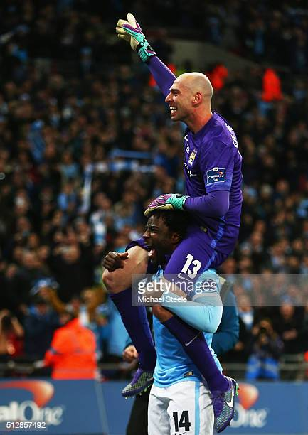 Wilfred Bony lifts goalkeeping hero Willy Caballero of Manchester City in celebration after the Capital One Cup Final match between Liverpool and...
