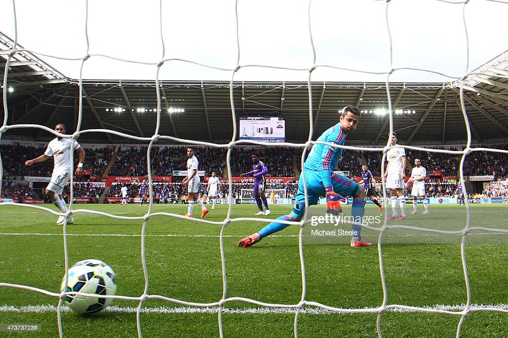 Wilfred Bony (C) of Manchester City scores his team's fourth goal past goalkeeper Lukasz Fabianski of Swansea City during the Barclays Premier League match between Swansea and Manchester City at the Liberty Stadium on May 17, 2015 in Swansea, Wales.