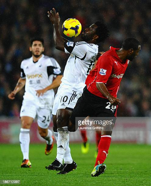 Wilfred Bony of Swansea battles with Kevin TheophileCatherine of Cardiff City during the Barclays Premier League match between Cardiff City and...
