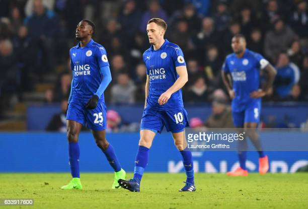 Wilfred Ndidi and Andy King of Leicester City look dejected as Juan Mata of Manchester United scores their third goal during the Premier League match...