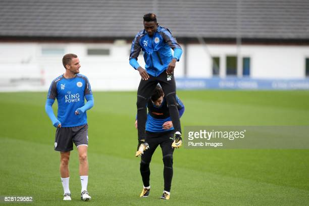 Wilfred Ndidi jumps over Ben Chilwell on the way out to training during the Leicester City training session at Belvoir Drive Training Complex on...