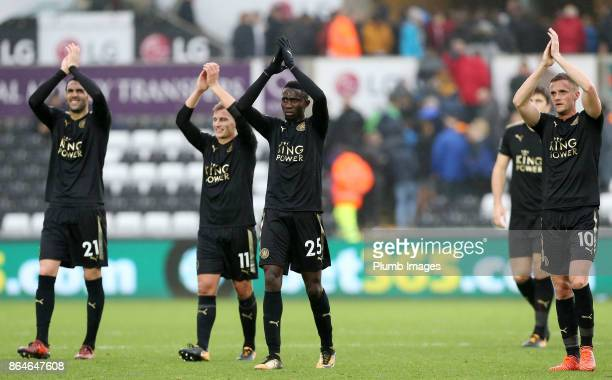 Wilfred Ndidi Marc Albrighton Vicente Iborra and Andy King of Leicester City celebrate after the final whistle of the Premier League match between...