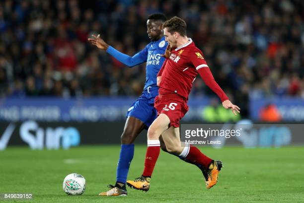 Wilfred Ndidi of Leicester City and Andy Robertson of Liverpool battle for possession during the Carabao Cup Third Round match between Leicester City...
