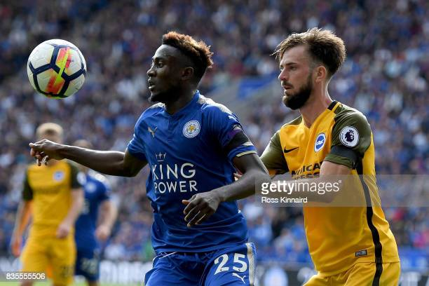 Wilfred Ndidi of Leicester City and Davy Propper of Brighton and Hove Albion battle for possession during the Premier League match between Leicester...