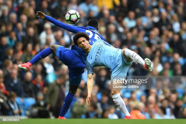 Wilfred Ndidi of Leicester City and Leroy Sane of Manchester City compete for the ball during the Premier League match between Manchester City and...