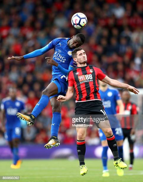 Wilfred Ndidi of Leicester City and Lewis Cook of AFC Bournemouth compete for the ball during the Premier League match between AFC Bournemouth and...