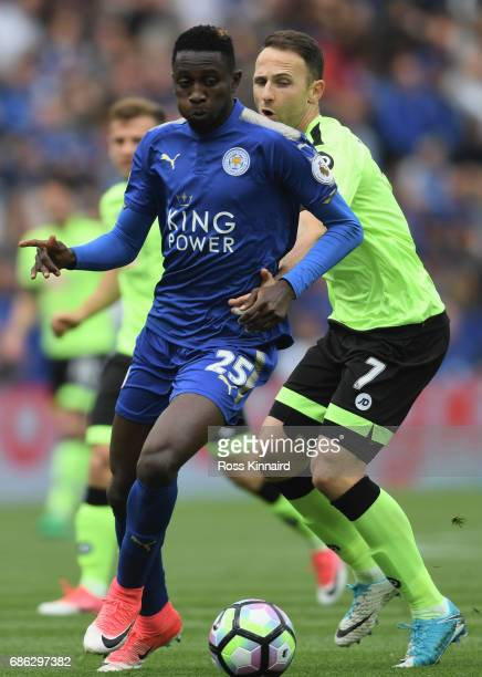 Wilfred Ndidi of Leicester City and Marc Pugh of AFC Bournemouth battle for the ball during the Premier League match between Leicester City and AFC...