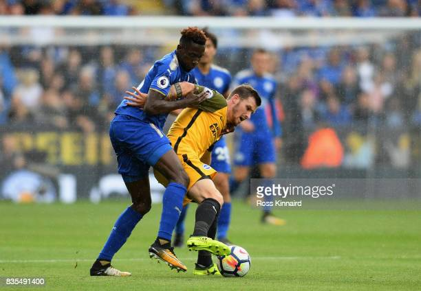 Wilfred Ndidi of Leicester City and Pascal Grob of Brighton and Hove Albion battle for possession during the Premier League match between Leicester...