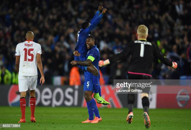 Wilfred Ndidi of Leicester City and Wes Morgan of Leicester City celebrate their victory as the final whistle blows during the UEFA Champions League...