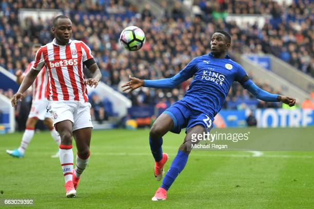 Wilfred Ndidi of Leicester City attempts to clear the ball while under pressure from Saido Berahino of Stoke City during the Premier League match...