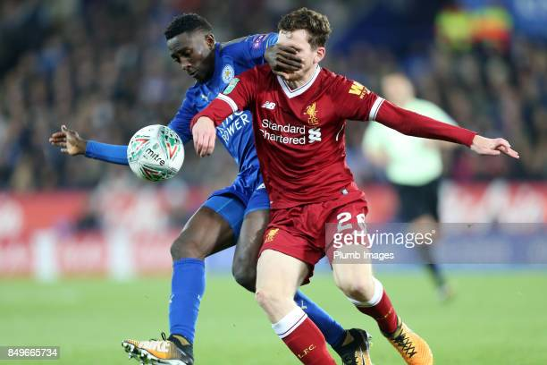 Wilfred Ndidi of Leicester City battles with Andrew Robertson of Liverpool during the Carabao Cup third round match between Leicester City and...
