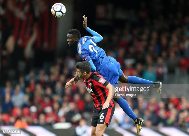 Wilfred Ndidi of Leicester City climbs above Andrew Surman of Bournemouth to head the ball during the Premier League match between Bournemouth and...