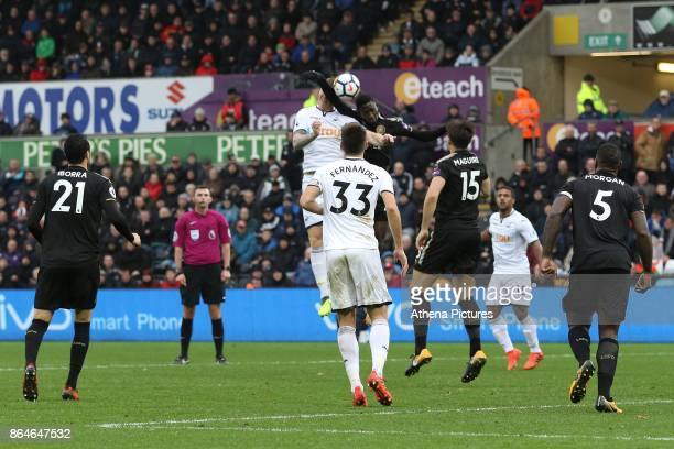 Wilfred Ndidi of Leicester City competes with Alfie Mawson of Swansea City during the Premier League match between Swansea City and Leicester City at...