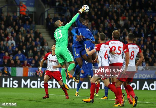 Wilfred Ndidi of Leicester City handles the ball in front of Boaz Myhill of West Bromwich Albion during the Premier League match between Leicester...