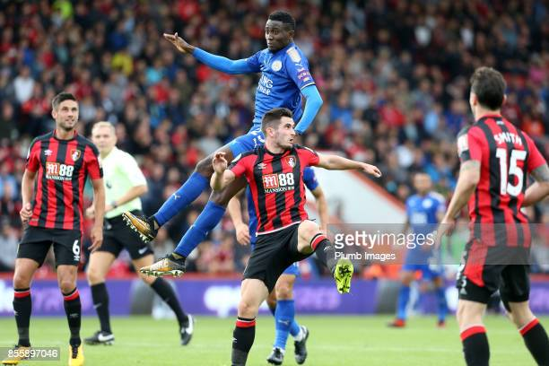Wilfred Ndidi of Leicester City in action with Andrew Surman of Bournemouth during the Premier League match between Bournemouth and Leicester City at...