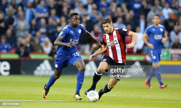 Wilfred Ndidi of Leicester City in action with Chad Evans of Sheffield United during the Carabao Cup Second Round tie between Sheffield United and...