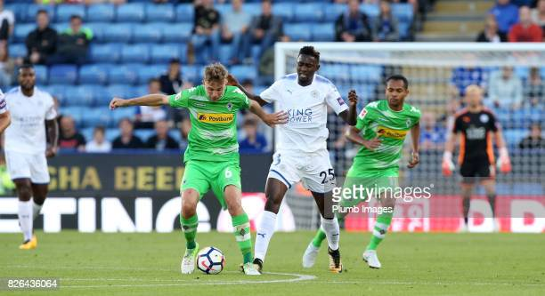 Wilfred Ndidi of Leicester City in action with Christoph Kramer of Borussia Monchengladbach during the Leicester City v Borussia Monchengladbach...