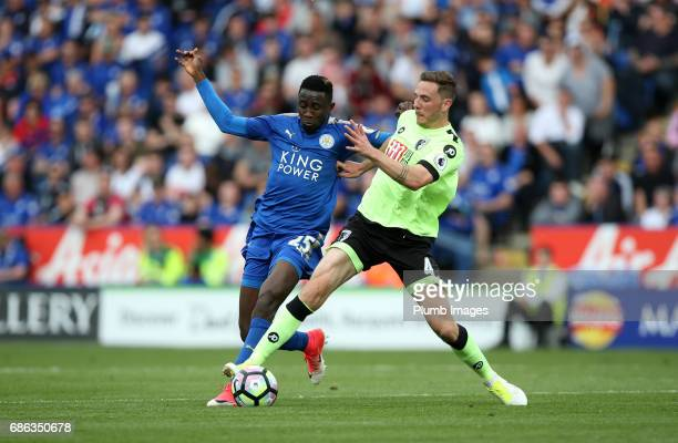 Wilfred Ndidi of Leicester City in action with Dan Gosling of Bournemouth during the Premier League match between Leicester City and Bournemouth at...