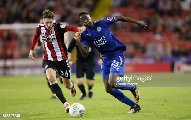 Wilfred Ndidi of Leicester City in action with David Brooks of Sheffield United during the Carabao Cup Second Round tie between Sheffield United and...