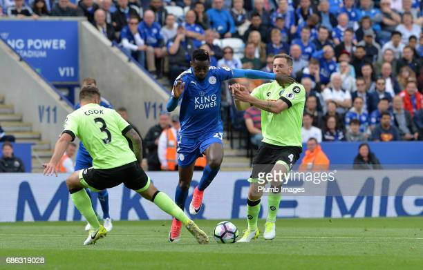 Wilfred Ndidi of Leicester City in action with Steve Cook and Dan Gosling of Bournemouth during the Premier League match between Leicester City and...