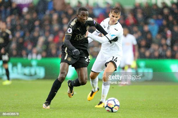 Wilfred Ndidi of Leicester City in action with Tom Carroll of Swansea City during the Premier League match between Swansea City and Leicester City at...