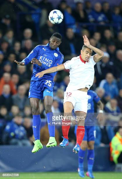 Wilfred Ndidi of Leicester City in action with Wissam Ben Yedder of Sevilla during the UEFA Champions League Round of 16 match between Leicester City...