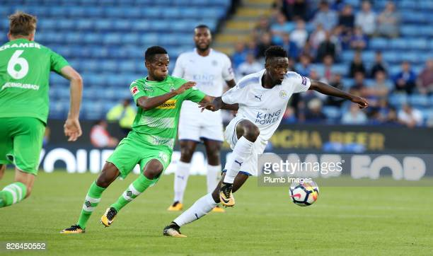 Wilfred Ndidi of Leicester City in acton with Ibrahima Traore of Borussia Monchengladbach during the Leicester City v Borussia Monchengladbach...