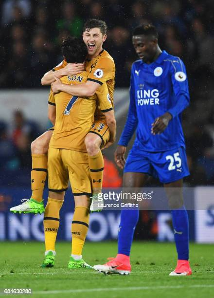Wilfred Ndidi of Leicester City looks dejected as HeungMin Son of Tottenham Hotspur celebrates as he scores their fourth goal with Ben Davies during...
