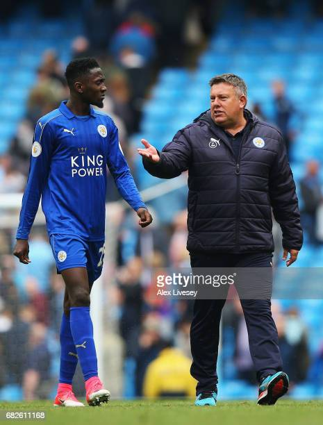 Wilfred Ndidi of Leicester City speaks to Craig Shakespeare manager of Leicester City as they walk off after the Premier League match between...