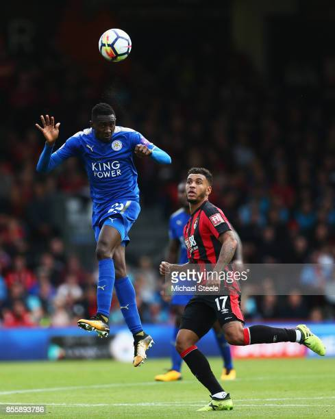 Wilfred Ndidi of Leicester City wins a header over Joshua King of AFC Bournemouth during the Premier League match between AFC Bournemouth and...