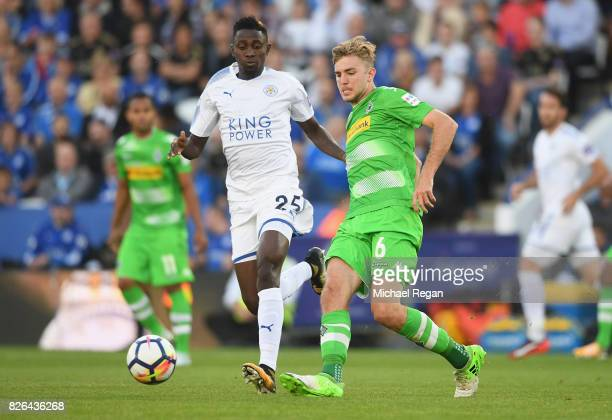 Wilfred Ndidi of Leicester in action with Christoph Kramer of Borussia Moenchengladbach during the preseason friendly match between Leicester City...