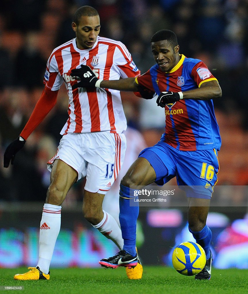 Wilfred Zaha of Crystal Palace battles with Steven Nzonzi of Stoke City during the FA Cup with Budweiser Third Round replay match between Stoke City and Crystal Palace at Britannia Stadium on January 15, 2013 in Stoke on Trent, England.