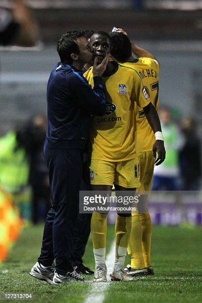 Wilfred Zaha of Crystal Palace gets a kiss from his manager Dougie Freeman after scoring his teams first goal of the game during the npower...