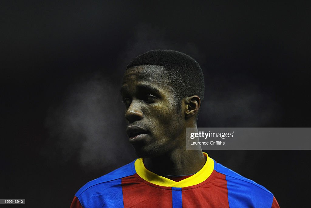 Wilfred Zaha of Crystal Palace looks on during the FA Cup with Budweiser Third Round replay match between Stoke City and Crystal Palace at Britannia Stadium on January 15, 2013 in Stoke on Trent, England.