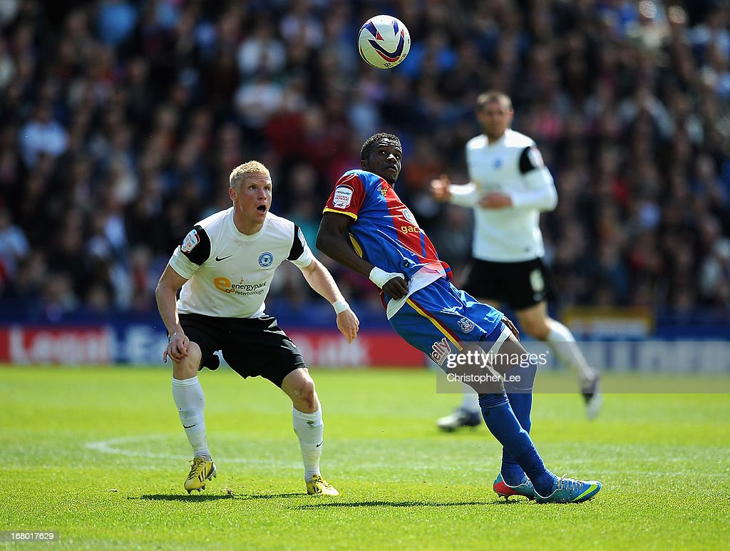 Wilfred Zaha of Palace battles with Craig Alcock of Peterborough during the npower Championship match between Crystal Palace and Peterborough United at Selhurst Park on May 04, 2013 in London, England.