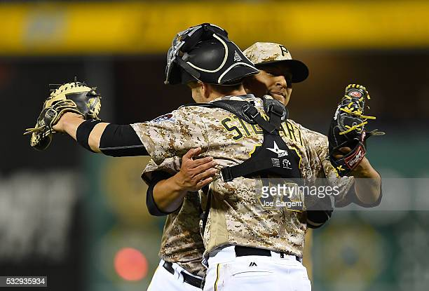 Wilfredo Boscan of the Pittsburgh Pirates celebrates with Chris Stewart after a 82 win over the Atlanta Braves on May 19 2016 at PNC Park in...
