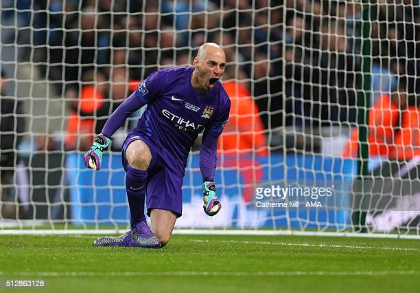 Wilfredo Caballero of Manchester City celebrates he saves a penalty during the Capital One Cup Final match between Liverpool and Manchester City at...