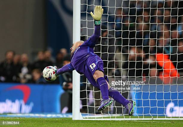 Wilfredo Caballero of Manchester City gets his finger tips to the ball as he makes a save during the Capital One Cup Final match between Liverpool...