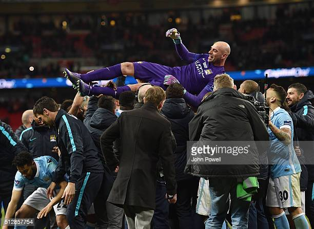 Wilfredo Caballero of Manchester City is congratulated after the final penalty is scored at the end of the Capital One Cup Final match between...
