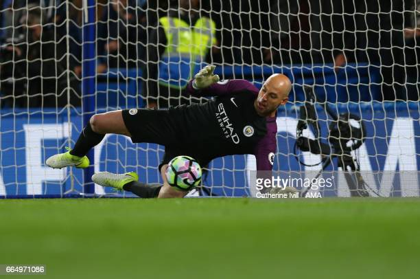 Wilfredo Caballero of Manchester City saves the penalty but fails to save the rebound during the Premier League match between Chelsea and Manchester...
